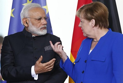 German Chancellor Merkel and Indian Prime Minister Modi talk before a signing ceremony at the 4th round of German-Indian government consultation at the Chancellery in Berlin